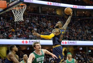 32768100-e3cf-11e4-a4d8-15f4c919a35b_LeBron-James-knifes-through-the-Celtics-def